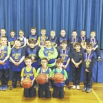 Holy Rosary third grade boys basketball was undefeated this season