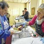 Volunteers serve the needy during free Thanksgiving dinner at First Baptist Church of Pittston Nov. 25