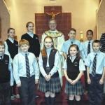 Wyoming Area Catholic School student council members lead prayers during Catholic Schools Week
