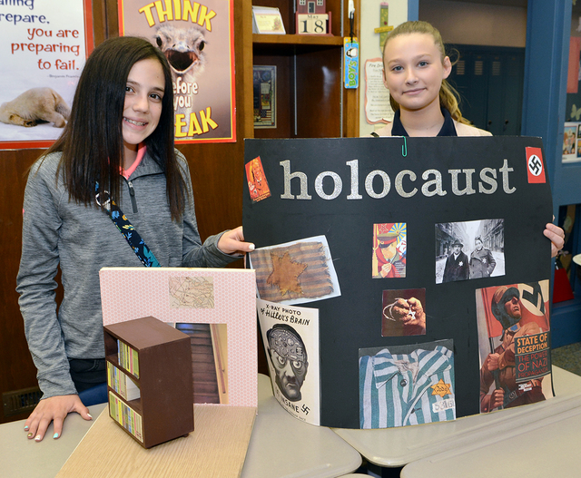 Martin L. Mattei seventh grade students present projects on the Holocaust in reading classes