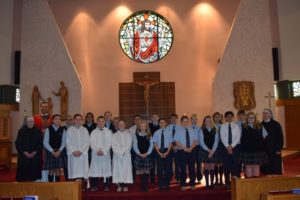 Wyoming Area Catholic School students present donations to The Little Sisters of the Poor