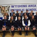 Seventh-grade student athletes at Wyoming Area Catholic School receive jackets