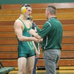 Wyoming Area wrestler Adam Buczynski working at continuing progress on mat