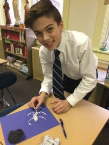 Seventh-grade students at Holy Rosary School in Duryea examine owl pellets