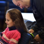 Daddy-daughter event at Pittston Library teaches fathers about girls' hairdos