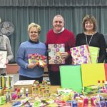 The General Federation of Women's Clubs-West Side distributes school supplies