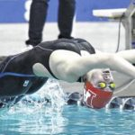 WVW swimmers send coach out with a title