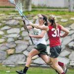 Wyoming Area girls lacrosse team climbing through the standings